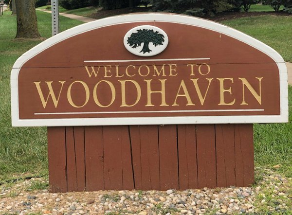 A sign of Welcome to Woodhaven